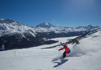 Skiers doing some ski runs on the Paradiso Piste, Corviglia